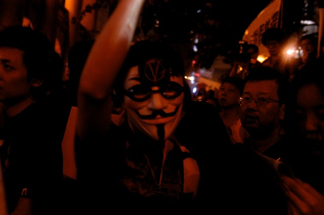 "Protester Wearing ""V for Vendetta"" Mask"
