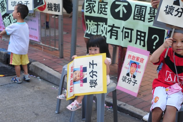 Starting them Young - this girl knows exactly what to do with her protest sign!