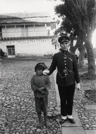 Policeman with boy; Cuzco, 1923.